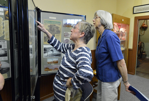Diane Barbour, left, and Betty Elder look through a display of photographs and newspaper stories during the Broomfield Depot Museum open house on Saturday.<br /> <br /> June23, 2012<br /> staff photo/ David R. Jennings