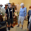 Tour guide Michael Sheinberg, 17, left, shows Lois Jouett a waffle iron  during a tour of the Broomfield Depot Museum for the open house on Saturday.<br /> <br /> June23, 2012<br /> staff photo/ David R. Jennings