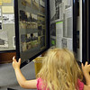 Phoebe Belanger, 2, looks at photographs  during the Broomfield Depot Museum open house on Saturday.<br /> <br /> June23, 2012<br /> staff photo/ David R. Jennings