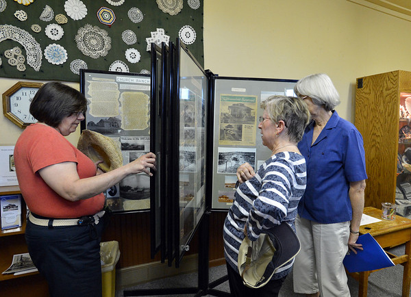 Libby Schultz, left,  Diane Barbour, and Betty Elder look through a display of photographs and newspaper stories during the Broomfield Depot Museum open house on Saturday.<br /> <br /> June23, 2012<br /> staff photo/ David R. Jennings