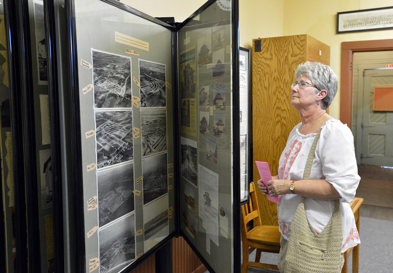 Norma Bigger looks at a display of photographs and newspaper articles during the Broomfield Depot Museum open house on Saturday.<br /> <br /> June23, 2012<br /> staff photo/ David R. Jennings