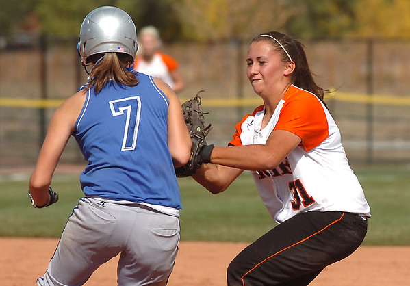 Erie's Tiffany Maul tags out Broomfield's Amelia Trotter during the regional tournament at The Ballpark at Erie on Saturday.<br /> <br /> October 15, 2011<br /> staff photo/ David R. Jennings