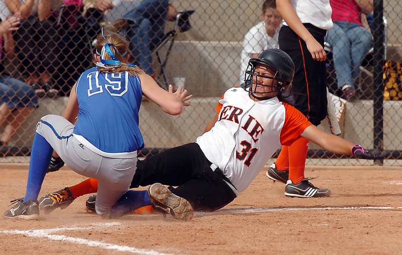 Erie's Tiffany Maul slides safely to home past Broomfield's Snelby Grandt during the regional tournament at The Ballpark at Erie on Saturday.<br /> October 15, 2011<br /> staff photo/ David R. Jennings