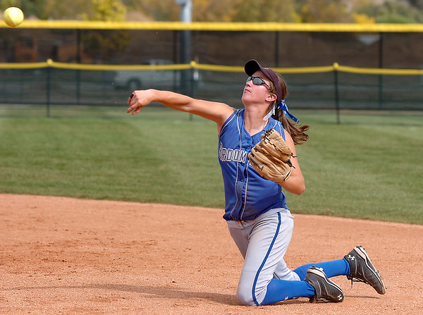 Broomfield's Lyndsey Babcock throws after catching an Erie ground ball during the regional tournament at The Ballpark at Erie on Saturday.<br /> October 15, 2011<br /> staff photo/ David R. Jennings