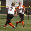 Erie's Carrie Clark and Kenzie Kudrna go after a Broomfield fly ball during the regional tournament at The Ballpark at Erie on Saturday.<br /> October 15, 2011<br /> staff photo/ David R. Jennings