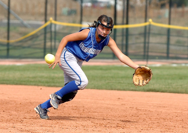 Broomfield's Isabelle Yamaguchi goes for an Erie infield ground ball during the regional tournament at The Ballpark at Erie on Saturday.<br /> October 15, 2011<br /> staff photo/ David R. Jennings