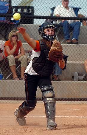 Erie's catcher Nicole Towner throws to first base after a  Broomfield bunt during the regional tournament at The Ballpark at Erie on Saturday.<br /> <br /> October 15, 2011<br /> staff photo/ David R. Jennings