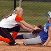 Erie's Claire Nibbe tags out Broomfield's Talia Finamore at third base during the regional tournament at The Ballpark at Erie on Saturday.<br /> <br /> October 15, 2011<br /> staff photo/ David R. Jennings