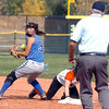 Broomfield's Isabelle Yamaguchi prepares to throw the ball after tagging out Erie's Bella Steinhauer during the regional tournament at The Ballpark at Erie on Saturday.<br /> October 15, 2011<br /> staff photo/ David R. Jennings