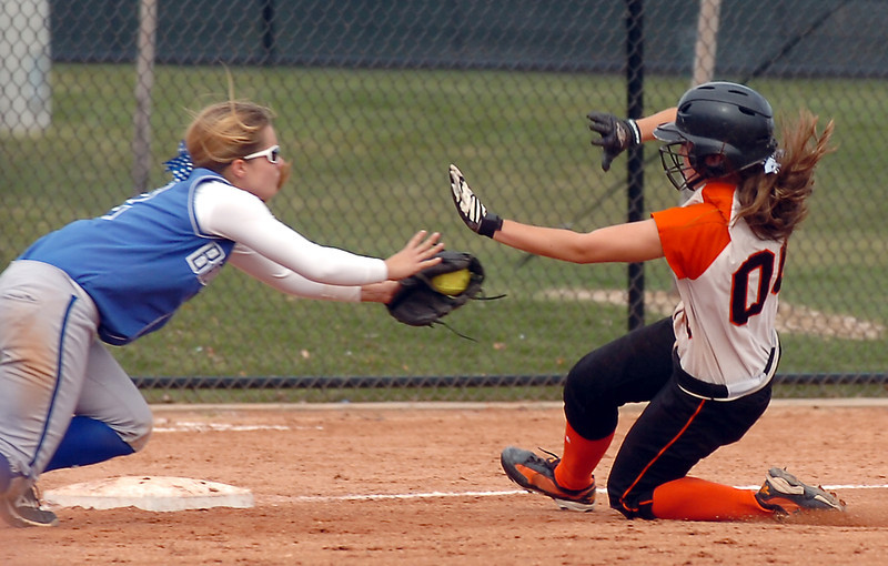 Broomfield's Katelin Knudson tags out Erie's Hannah Goodard during the regional tournament at The Ballpark at Erie on Saturday.<br /> <br /> October 15, 2011<br /> staff photo/ David R. Jennings