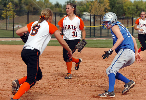 Erie's Amanda Ochoa chases down and tags out Broomfield's Shelby Grandt during the regional tournament at The Ballpark at Erie on Saturday.<br /> October 15, 2011<br /> staff photo/ David R. Jennings