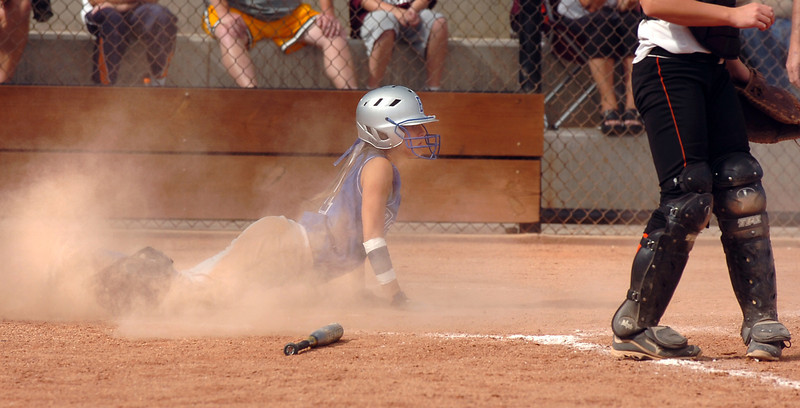 Broomfield's Rebecca Israel slides safely home against  Erie during the regional tournament at The Ballpark at Erie on Saturday.<br /> <br /> October 15, 2011<br /> staff photo/ David R. Jennings