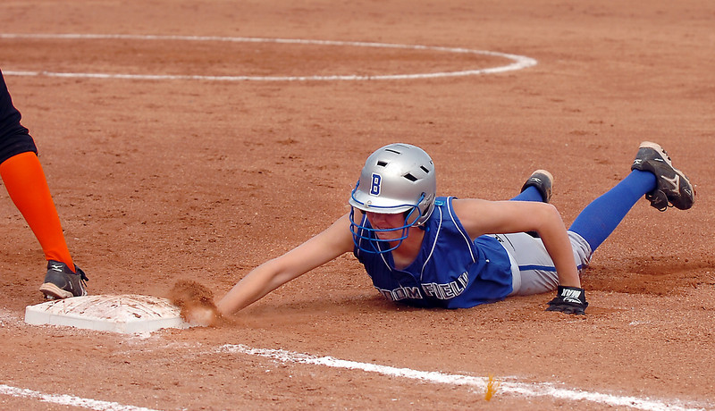 Broomfield's Selby Grandt slides safely back to first base during play against Erie in the regional tournament at The Ballpark at Erie on Saturday.<br /> October 15, 2011<br /> staff photo/ David R. Jennings