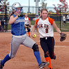 Broomfield's Carson Platnick races to beat Erie's Amanda Ochoa to first base during the regional tournament at The Ballpark at Erie on Saturday.<br /> October 15, 2011<br /> staff photo/ David R. Jennings