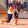 Erie's Tiffany Maul bunts the ball against Broomfield during the regional tournament at The Ballpark at Erie on Saturday.<br /> <br /> October 15, 2011<br /> staff photo/ David R. Jennings