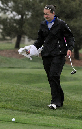 Broomfield's Taylor Dorans walks to her ball after wiping rain  off of her face on the 13th during Thursday's tournament at Eagle Trace Golf Course.<br /> <br /> April 22, 2010<br /> Staff photo/David R. Jennings