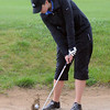 Broomfield's Alex Briggs chips the ball out of a partially flooded sand trap on the 13th during Thursday's tournament at Eagle Trace Golf Course.<br /> <br /> April 22, 2010<br /> Staff photo/David R. Jennings