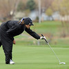 Broomfield's Lauren Hamilton studies the 13th green before making a putt during Thursday's tournament at Eagle Trace Golf Course.<br /> <br /> April 22, 2010<br /> Staff photo/David R. Jennings
