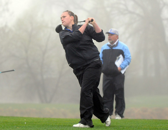 Broomfield's Danielle Dorans tees off of the 10th in the fog during the tournament Thursday at Eagle Trace Golf Course.<br /> <br /> April 22, 2010<br /> Staff photo/David R. Jennings