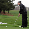 Broomfield's Taylor Dorans makes a putt in the rain on the 13th during Thursday's tournament at Eagle Trace Golf Course.<br /> <br /> April 22, 2010<br /> Staff photo/David R. Jennings