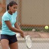 Broomfield's No. 1 singles player Naomi Haldpainen returns the ball against Longmont during play on Thursday at Longmont High School.<br /> <br /> April 21, 2011<br /> staff photo/David R. Jennings