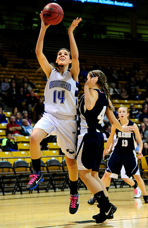 BFGIRLS<br /> Broomfield's Katie Nehf gets a shot past Erin Todd of Air Academy.<br /> Photo by Marty Caivano/March 9, 2011