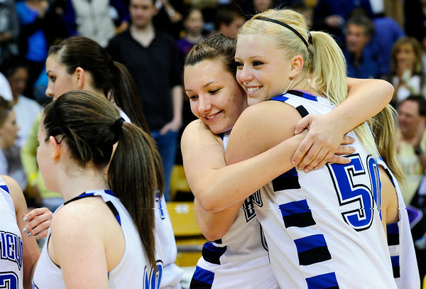 BFGIRLS<br /> Broomfield's Stacie Hull, left, and Bre Burgesser hug after their win against Air Academy in the 4A Final Four.<br /> Photo by Marty Caivano/March 9, 2011