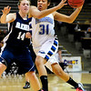 BFGIRLS<br /> Broomfield's Tyana Medema drives past Kate Louthan of Air Academy.<br /> Photo by Marty Caivano/March 9, 2011