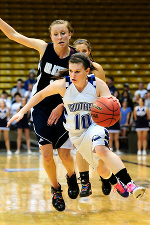 BFGIRLS<br /> Broomfield's Bri Wilber pushes past Kellyn Roiko of Air Academy.<br /> Photo by Marty Caivano/March 9, 2011