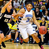 BFGIRLS<br /> Broomfield's Tyana Medema drives past Kellyn Koiko of Air Academy.<br /> Photo by Marty Caivano/March 9, 2011