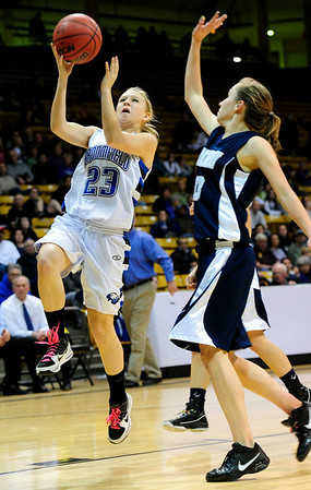 BFGIRLS<br /> Broomfield's Morgan Rynearson shoots past Kellyn Roiko of Air Academy.<br /> Photo by Marty Caivano/March 9, 2011