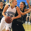 Bre Burgesser, Broomfield, drives for a lay-up past Sarah Austin, Fossil Ridge during Friday's game at Broomfield.<br /> <br /> <br /> December 18, 2009<br /> Staff photo/David R. Jennings