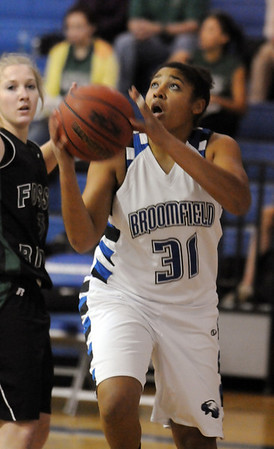 Broomfield's Tyana Medema goes for two against Fossil Ridge during Friday's game at Broomfield.<br /> <br /> <br /> December 18, 2009<br /> Staff photo/David R. Jennings