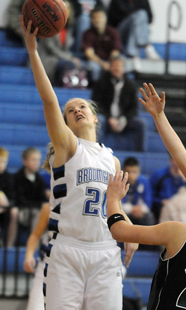 Meagan Prins, Broomfield goes up for two against Fossil Ridge during Friday's game at Broomfield.<br /> <br /> <br /> December 18, 2009<br /> Staff photo/David R. Jennings