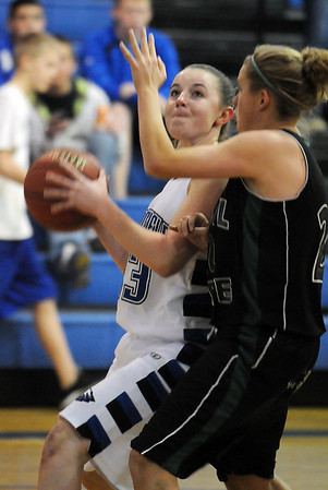 Broomfield's Sarah Hix, works her way to the basket against Kylee Willer, Fossil Ridge during Friday's game at Broomfield.<br /> <br /> <br /> December 18, 2009<br /> Staff photo/David R. Jennings