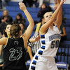 Broomfield's Bre Burgesser, right, goes for two past Marissa DeMario, Fossil Ridge during Friday's game at Broomfield.<br /> <br /> <br /> December 18, 2009<br /> Staff photo/David R. Jennings