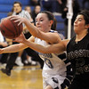 Broomfield's Sarah Hix, goes for a loose ball against Ashley Ambriz, Fossil Ridge during Friday's game at Broomfield.<br /> <br /> <br /> December 18, 2009<br /> Staff photo/David R. Jennings