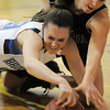 Broomfield's Sarah Hix fights for possession of the ball with Fossil Ridge's Marissa DeMario during Friday's game at Broomfield.<br /> <br /> <br /> December 18, 2009<br /> Staff photo/David R. Jennings