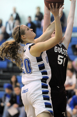 Meagan Prins, Broomfield shoots the ball against Haley Blodgett, Golden during Friday's 2ndround of the state 4A girls playoffs at Broomfield.<br /> February 25, 2011<br /> staff photo/David R. Jennings