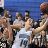 Katie Nehf, Broomfield rebounds the ball while colliding with Shannon Seery, Golden during Friday's 2ndround of the state 4A girls playoffs at Broomfield.<br /> February 25, 2011<br /> staff photo/David R. Jennings
