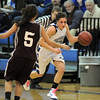 Brittney Zec,  Broomfielddrives the ball downcourt against Missy Conklin, Golden during Friday's 2ndround of the state 4A girls playoffs at Broomfield.<br /> February 25, 2011<br /> staff photo/David R. Jennings