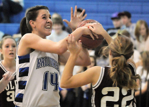 Katie Nehf, Broomfield fights for possession of the ball against Annie Fauble, Golden during Friday's 2ndround of the state 4A girls playoffs at Broomfield.<br /> February 25, 2011<br /> staff photo/David R. Jennings