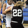 Tyana Medema, Broomfield fights for possession of the ball with Annie Fauble, Golden during Friday's 2ndround of the state 4A girls playoffs at Broomfield.<br /> February 25, 2011<br /> staff photo/David R. Jennings