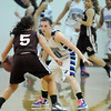 Bre Wilber, Broomfield blocks the advance of Missy Conklin, Golden during Friday's 2ndround of the state 4A girls playoffs at Broomfield.<br /> February 25, 2011<br /> staff photo/David R. Jennings