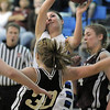 Brittney Zec, Broomfield rebounds the ball against Kaitlyn Tripp, Golden during Friday's 2ndround of the state 4A girls playoffs at Broomfield.<br /> February 25, 2011<br /> staff photo/David R. Jennings