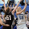 Bre Burgesser,  Broomfield goes to the basket against Haley Blodgett,  Golden during Friday's 2ndround of the state 4A girls playoffs at Broomfield.<br /> February 25, 2011<br /> staff photo/David R. Jennings