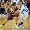 Broomfield's Nicole Lehrer, right, fights for a loose ball against Sierra's Tracy Marks during Saturday's state 45A playoff game at Broomfield.<br /> February 24, 2012 <br /> staff photo/ David R. Jennings