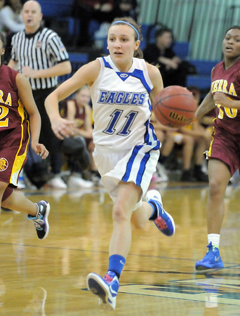 Broomfield's Katie Croell drives the ball down court against Sierra during Saturday's state 4A playoff game at Broomfield.<br /> February 24, 2012 <br /> staff photo/ David R. Jennings