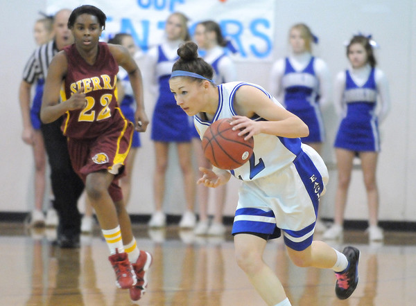 Broomfield's Brittney Zec drives the ball down court against Sierra during Saturday's state 4A playoff game at Broomfield.<br /> February 24, 2012 <br /> staff photo/ David R. Jennings
