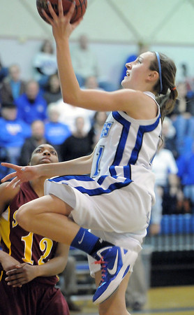 Broomfield's Katie Croell goes to the basket past Sierra's Makayla Davis during Saturday's state 4A playoff game at Broomfield.<br /> February 24, 2012 <br /> staff photo/ David R. Jennings